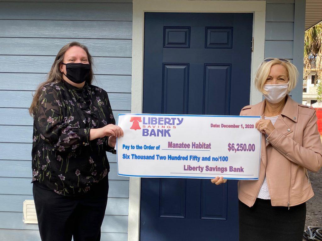 Lauren Fuller with Liberty Savings Bank and Diana Shoemaker, CEO Manatee Habitat